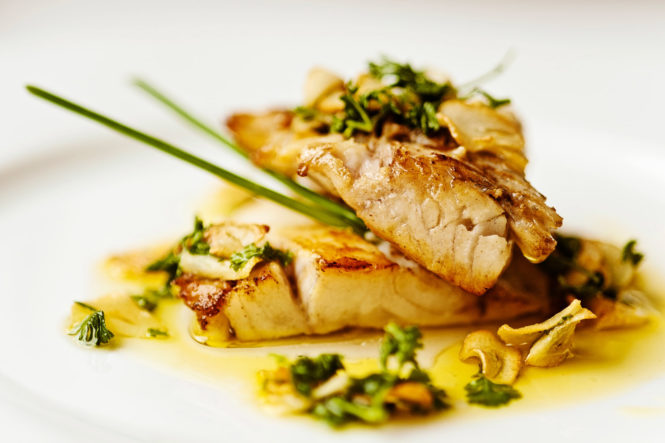 Food picture Fish with parsley sauce in restaurant